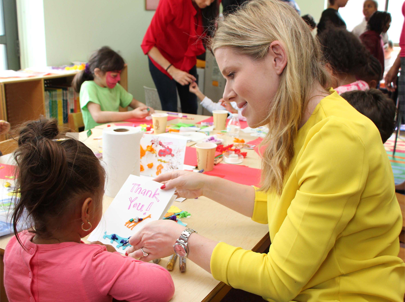 NYFC volunteer Hana Bitton doing craft activities with a child at the ACS Children's Center