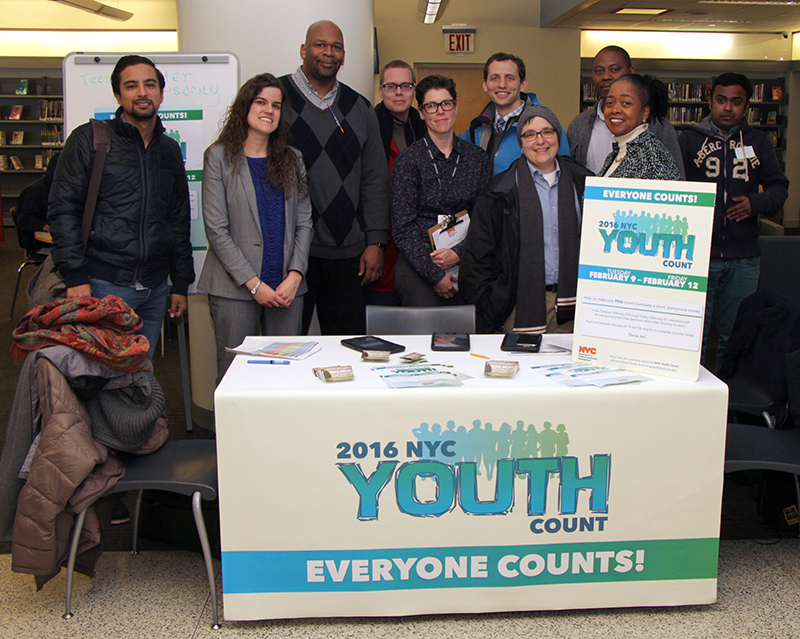 Volunteers staffing a table at the homeless youth count