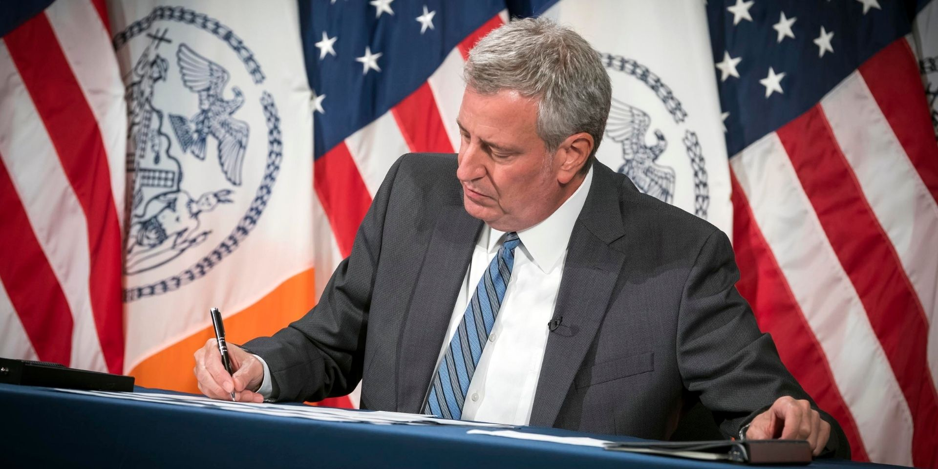 Photo of Mayor de Blasio giving pen that was used for bill signing to DCA Commissioner Salas