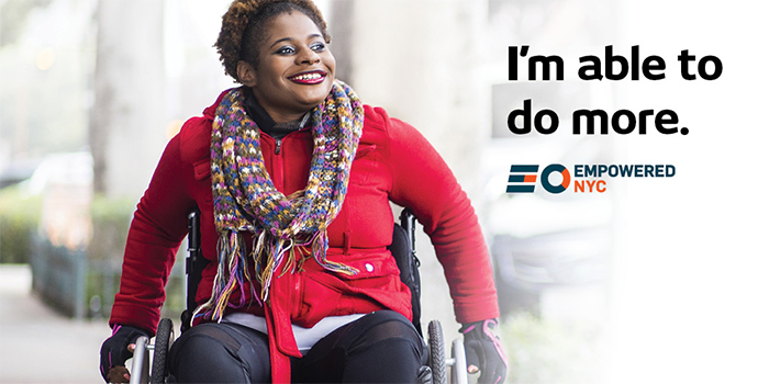 A smiling black woman in a wheelchair rolls down a public sidewalk. Headline text is, I'm able to do more. EmpoweredNYC logo is below text.