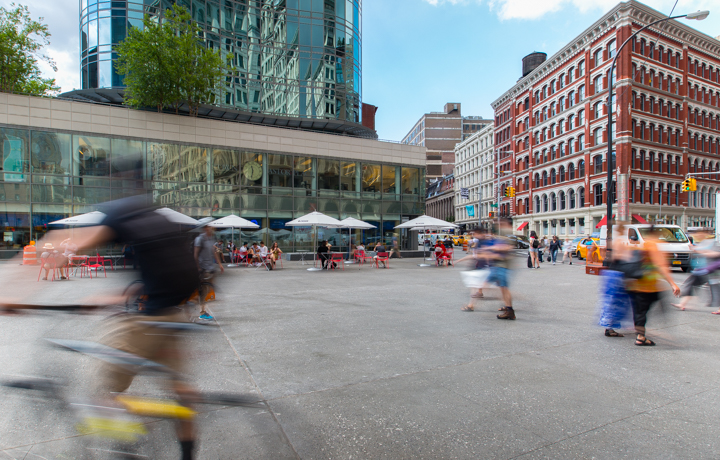people walking around the newly reconstructed astor place