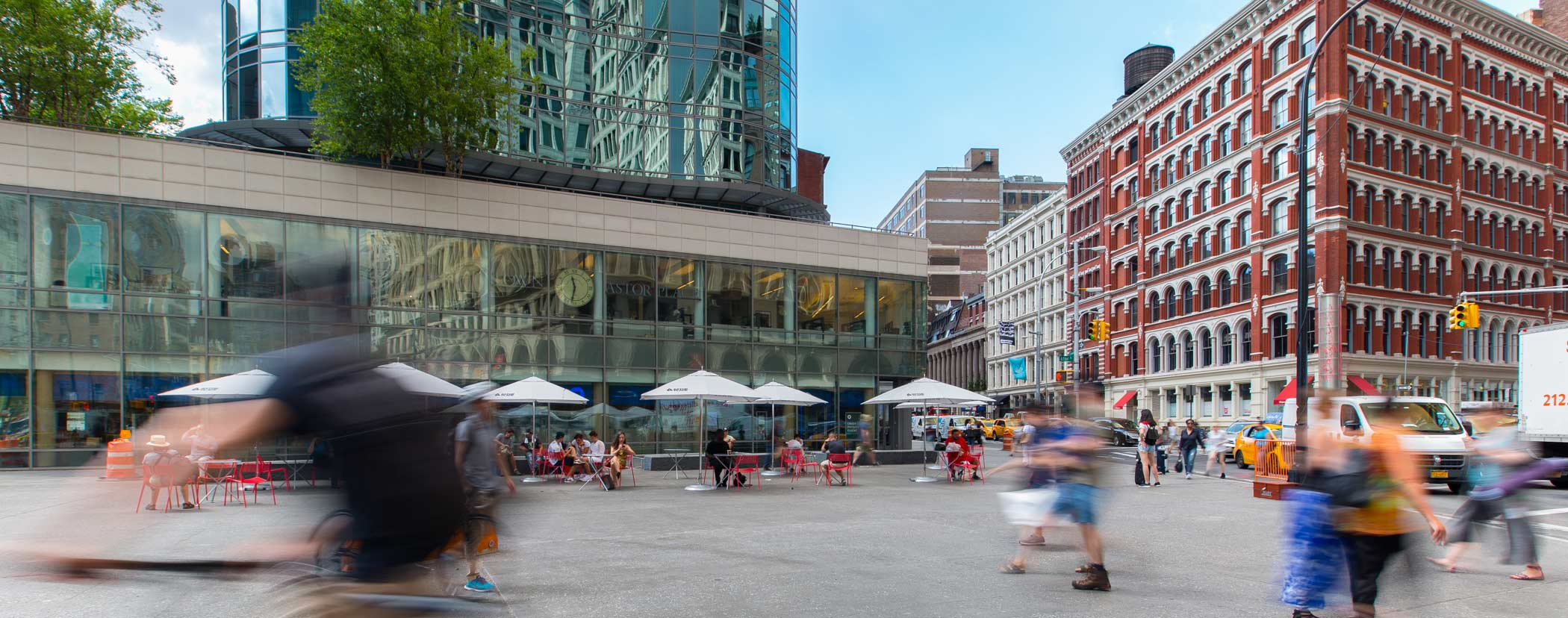 people walking around the newly reconstructed astor place.