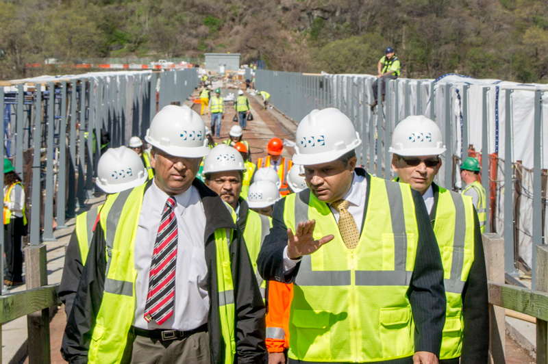Commisioner Peña-Mora (right) is reviews construction on the High Bridge.