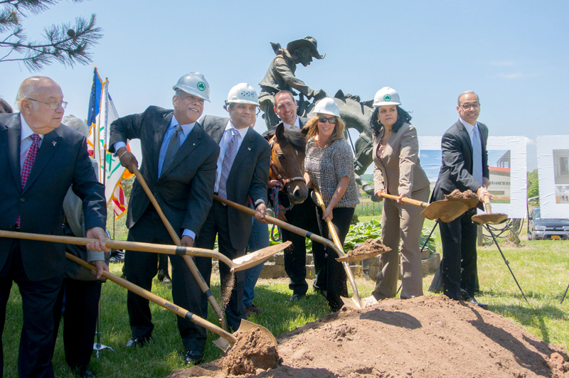 Commissioner Peña-Mora and community leaders break ground.