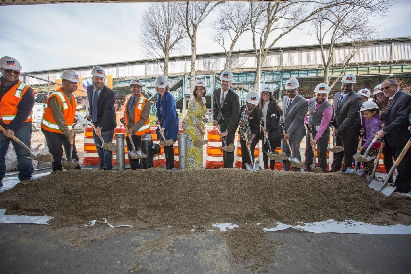 city officials joined for the Corona Plaza groundbreaking