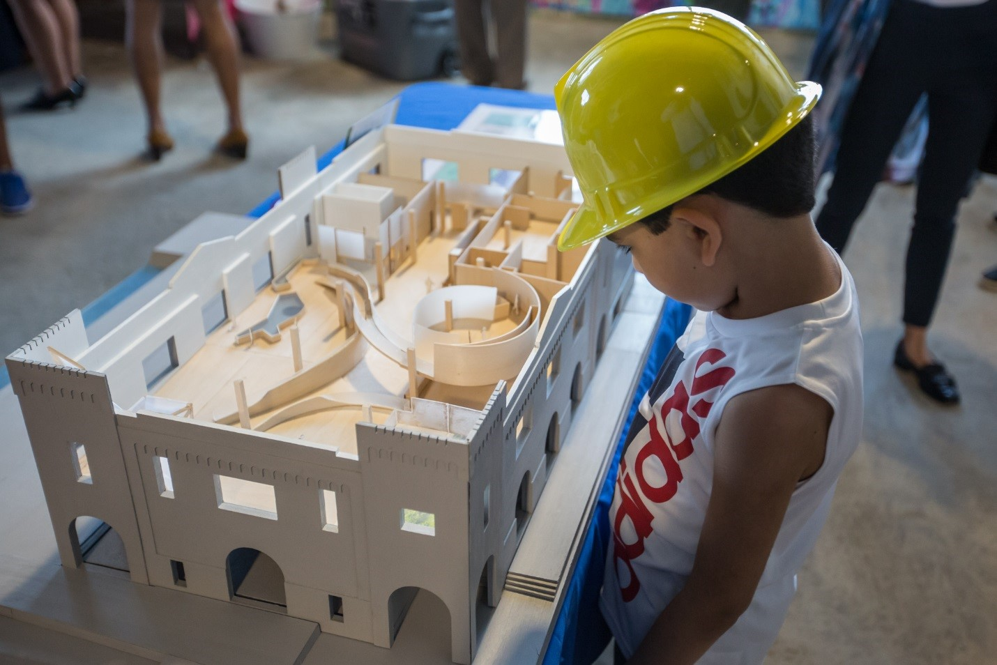 A kid at the groundbreaking ceremony