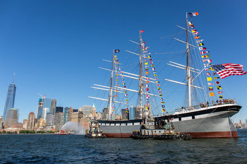 A far away shot of the Wavertree, decked out in international flags, as it floats in the NYC harbor.