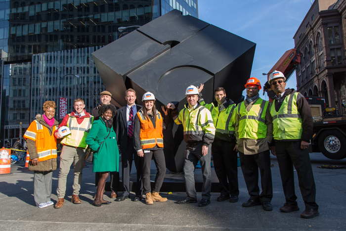 ddc employees in front of astor cube
