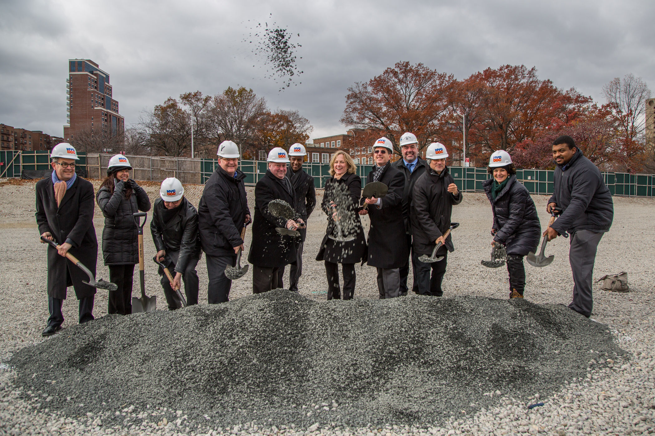 project team and borough president breaking ground
