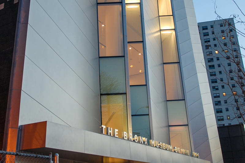 The facade of the Bronx Museum of Art at night.