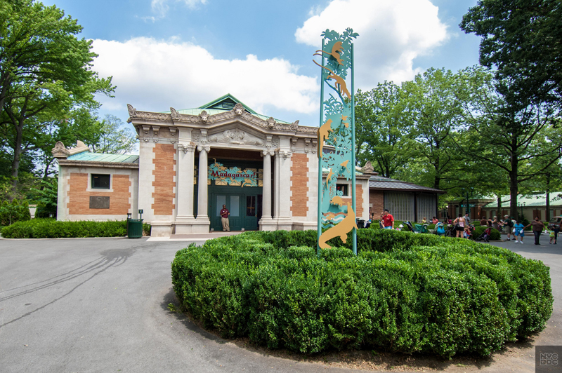 People walking into the entrance of the Bronx Zoo