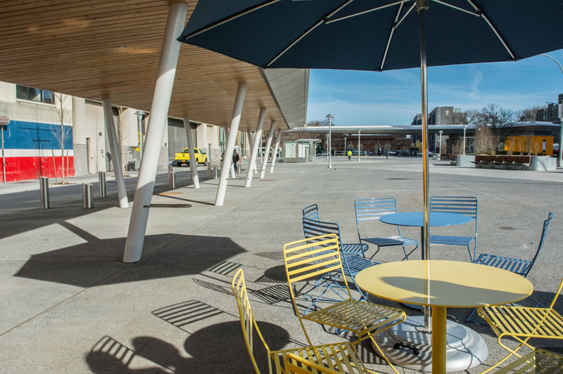 Tables and chairs for pedestrians at Fordham Plaza.