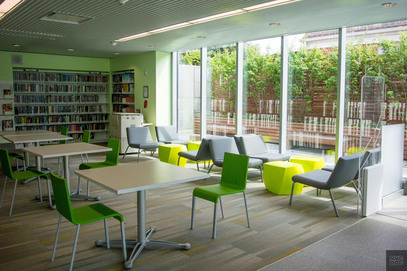 Inside the Glen Oaks Library, tables and chairs make up the teen study area.