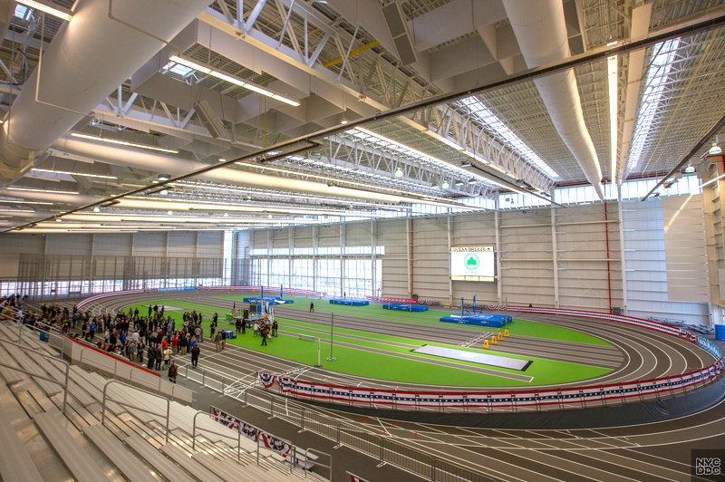 Inside the Ocean Breeze Athletic Center. Looking down at the track from the bleachers.