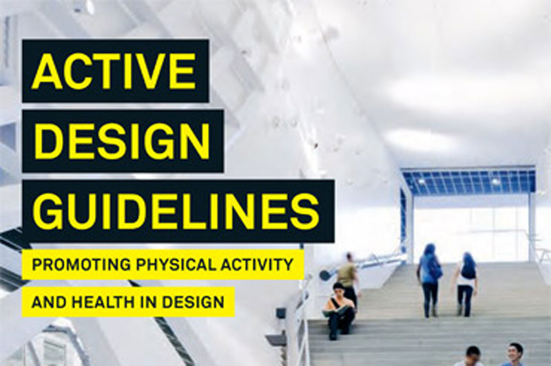 Cover for the Active Design Guidelines. People are walking up and down a wide stairway.