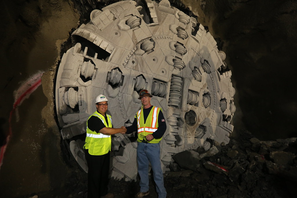 Commissioner Sapienza and Foreman Standing in Front of Tunnel Boring Machine