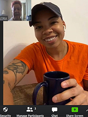 Two females, one younger and one older, chat over the a video call