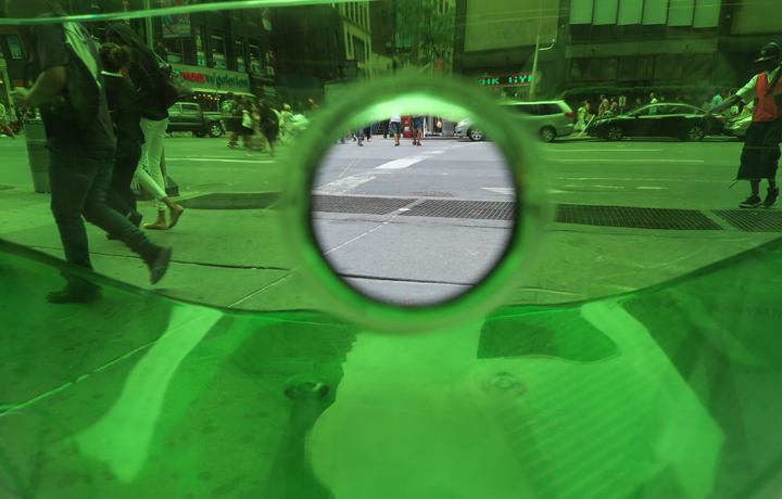 Looking at a NYC street through a green bottle