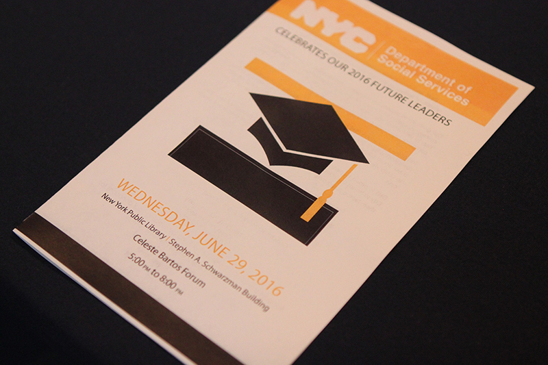 Event program with graduation cap image on cover