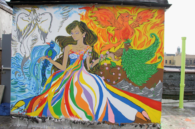 mural of woman with rainbow colored dress and four birds