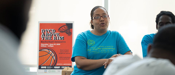 A young lady is talking during the Above the Rim workshop.