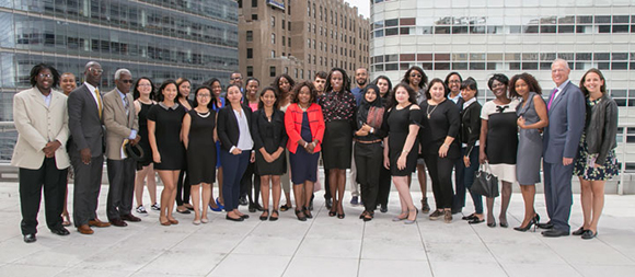 The 2017 NYCHA-CUNY scholarship winners are holding up their awards.