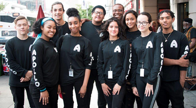 Interns standing outside of the Apollo.