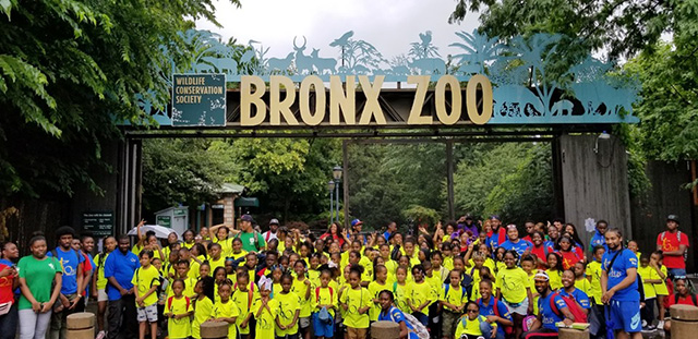 Summer Camppers standing in the front of the Bronx Zoo