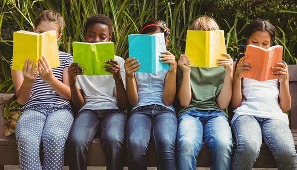 Youth reading while outside.