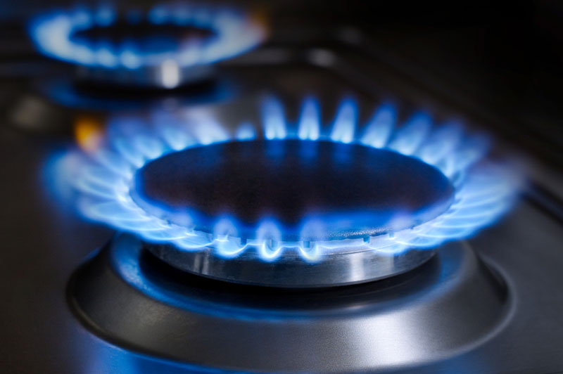 A close-up photo of gas burners on a stove