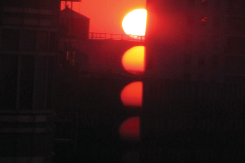 A photo of the sun at sunset.