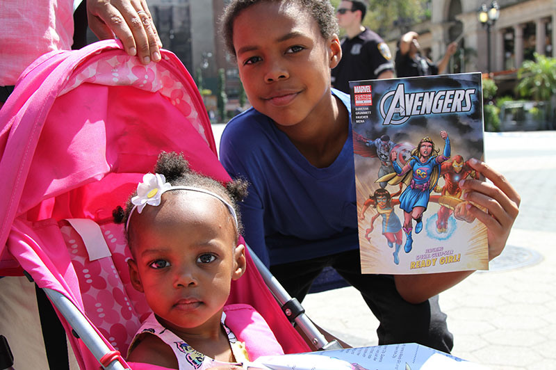 New York City kids posing with the Ready Girl comic book