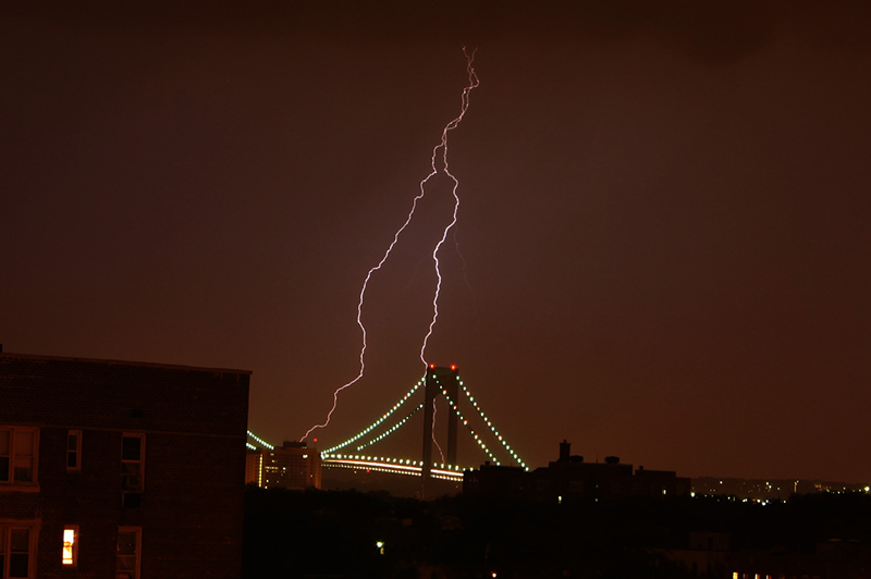 A lightning storm over a bridge.