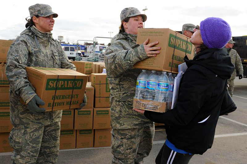 Woman receives water and meal for recovery.