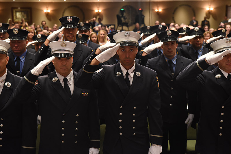 Fire Officers saluting at promotion ceremony