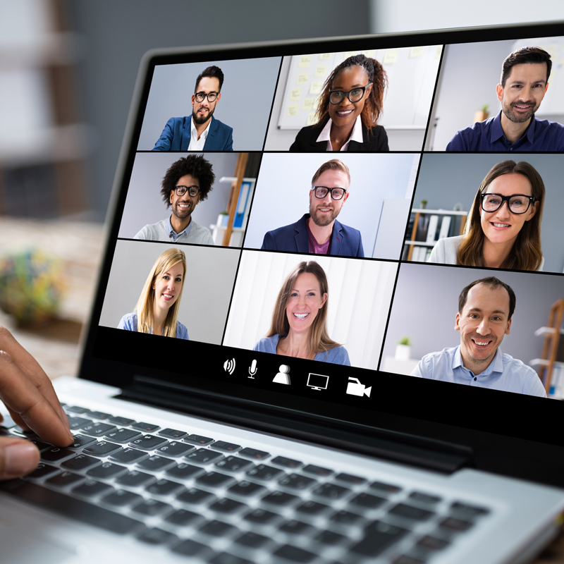 Photo of a laptop with multiple people on a video conference