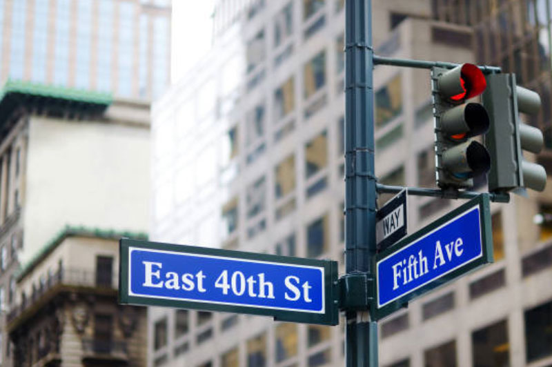 A photo of street signs at an intersection of East 40th Street and Fifth Avenue