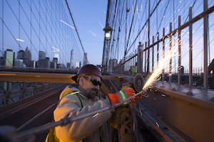 Department of Transportation employee performs maintenance on Brooklyn Bridge