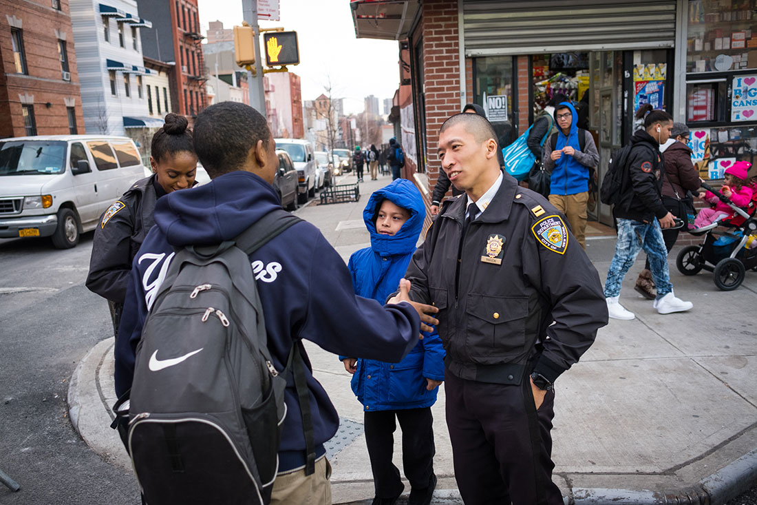 Photo of officers and people on the street