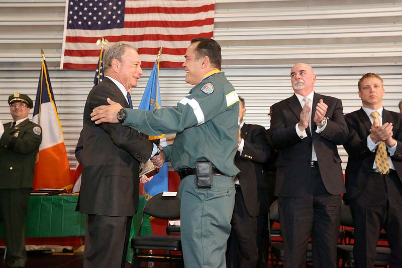 Swearing in new sanitation workers, recognizing promotions and presenting medals of honors
