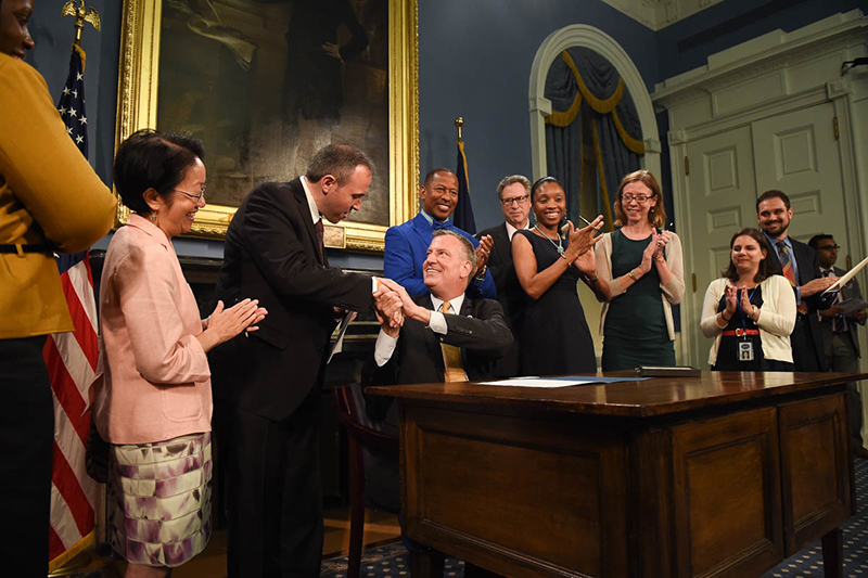 Mayor de Blasio Signs Legislation to Waive Building Fees For 'Build It Back' Homeowners