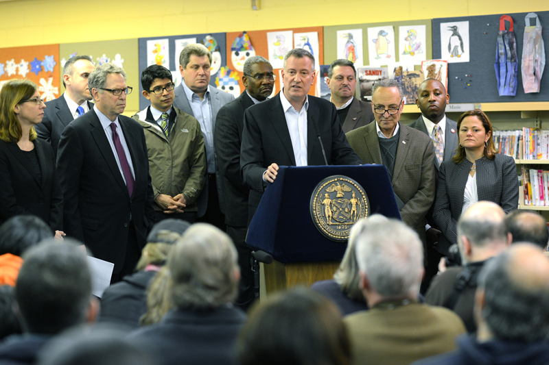 Mayor de Blasio standing with Sen. Schumer