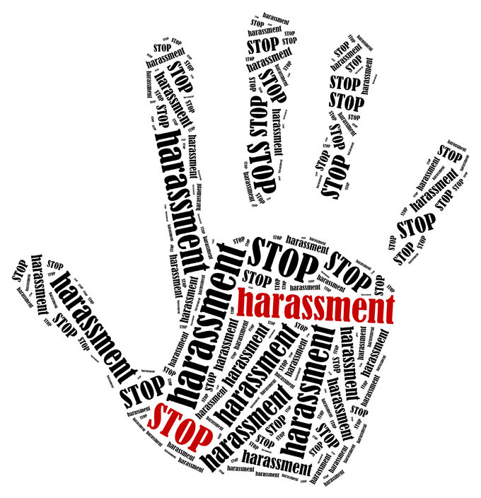 the words stop harassment in the shape of a open palm