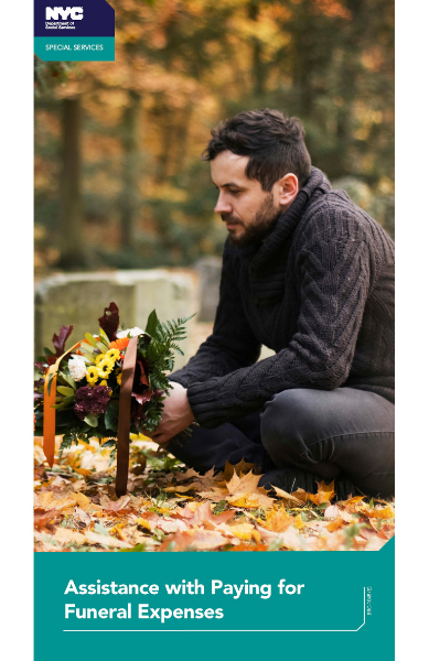 Image of a man at a grave with flowers