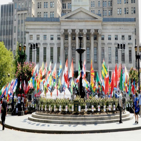 Brooklyn Borough Hall with flags in front of the building