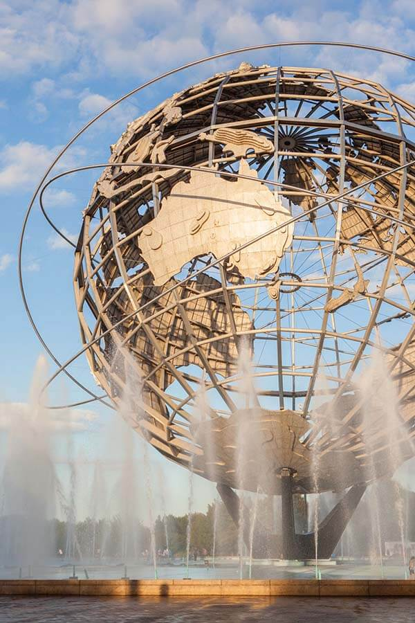 The Unisphere in Queens, a metal globe structure with a fountain underneath.