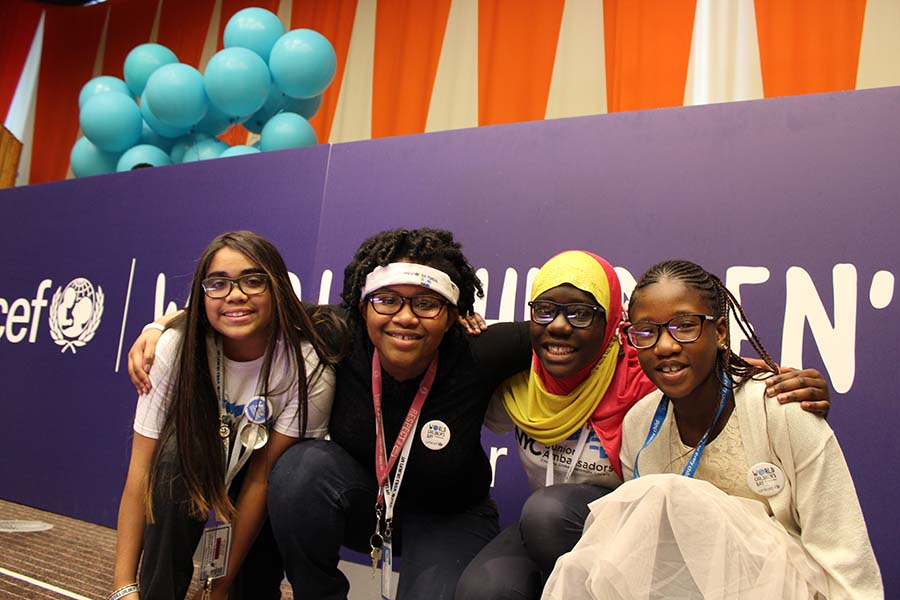 Four NYC Junior Ambassadors alumni pose together at the UNICEF World Children's Day event
