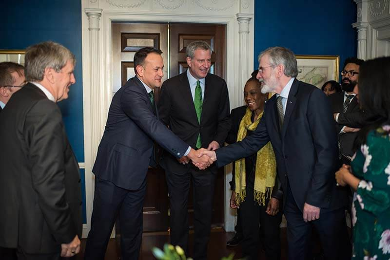 Toaiseach (Prime Minister) Leo Varadkar and Gerry Adams, former President of Sinn Féin, shake hands before Mayor de Blasio and First Lady McCray.