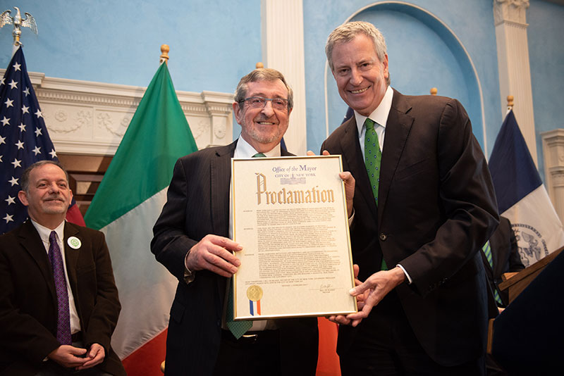 Honoree Michael J. Dowling and Mayor Bill de Blasio holding the proclamation gifted to Michael J. Dowling.
