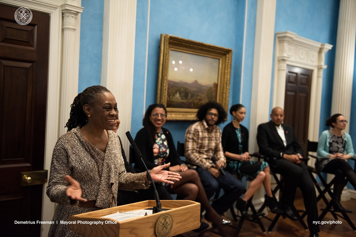 Lady Chirlane McCray hosting a panel discussion while speakers watch and listen